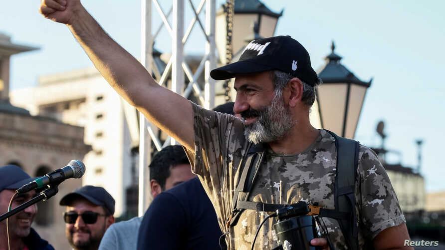 Armenian opposition leader Nikol Pashinyan gestures to his supporters at a rally in Yerevan, Armenia, May 2, 2018.