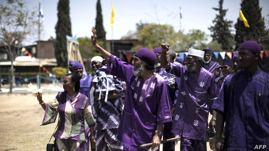 FILE - Ben Ami Ben Israel (C), spiritual leader of Arican Hebrews, is seen with followers at a celebration May 26, 2010, in the southern Israeli town of Dimona.
