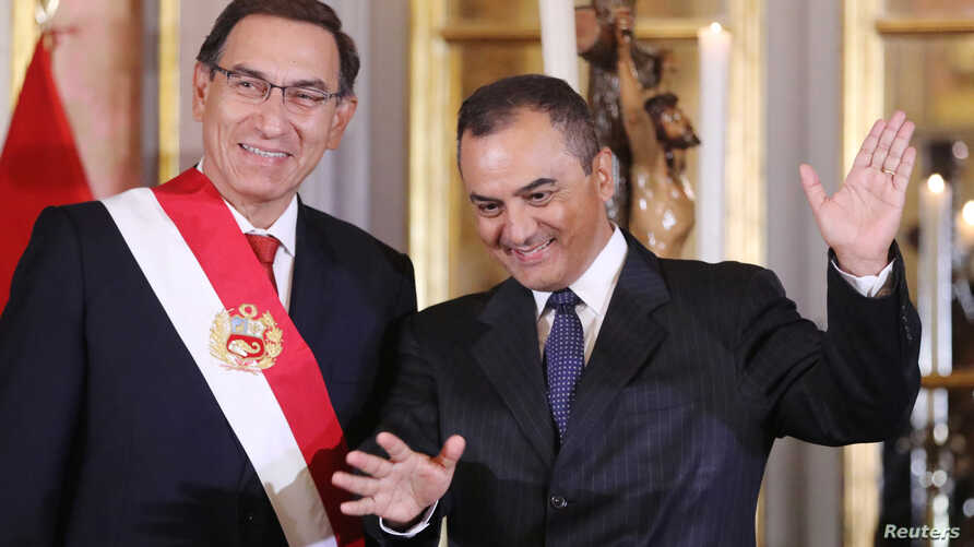 Peru's President Martin Vizcarra and new Finance Minister Carlos Oliva gesture during a swearing-in ceremony at the government palace in Lima, Peru, June 7, 2018.