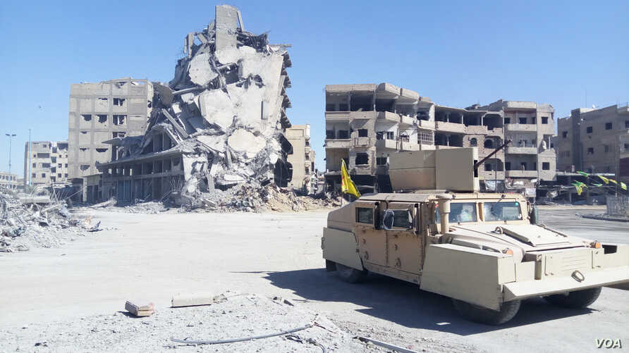 """Na'eem Square, or Heaven Square, was nicknamed """"Hell Square"""" under IS rule because the corpses of the executed were left in the left there ti instill fear in those not aligned with the jihadist militants, in Raqqa, Syria, Oct. 18, 2017. (H. Arafat/VO"""