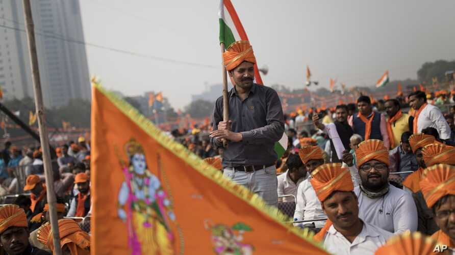 Supporters of Vishwa Hindu Parishad gather during a rally in New Delhi, Dec. 9, 2018. The group gathered thousands of supporters in the Indian capital to demand the construction of a Hindu temple on a site where a mosque was attacked and demolished i