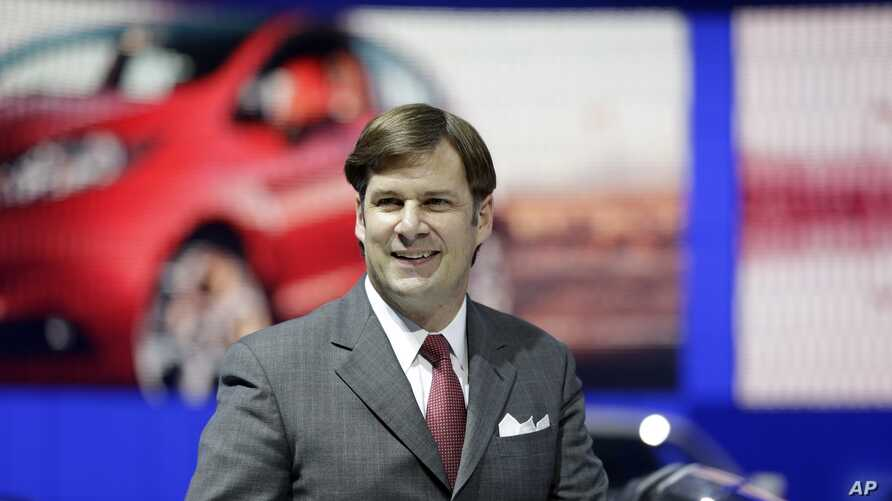 Ford Motor Co. executive Jim Farley is seen in the automaker's display area at the North American International Auto Show in Detroit, Jan. 13, 2014.