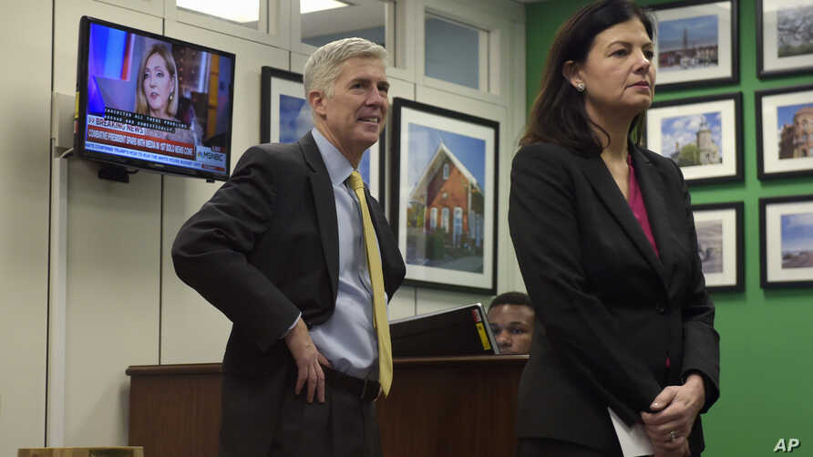 Supreme Court Justice nominee Neil Gorsuch and former New Hampshire Sen. Kelly Ayotte wait for a meeting with Sen. Chris Murphy, D-Conn. on Capitol Hill in Washington, Feb. 16, 2017.