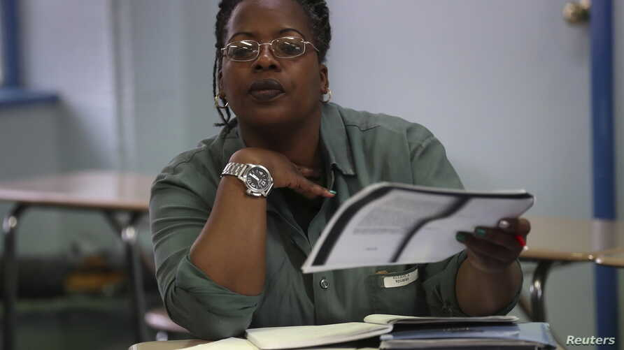 Inmate Aisha Elliott studies during her class at the Taconic Correctional Facility in Bedford Hills, N.Y., April 8, 2016. Taconic inmates are reading classical literature in a Columbia University course, organized by the Hudson Link for Higher Educat