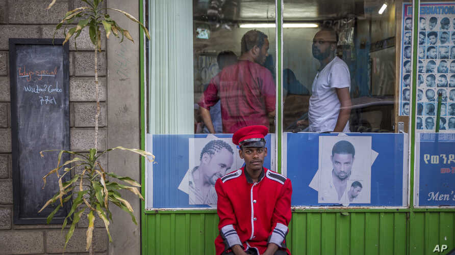 A security guard sits near a gate in Addis Ababa, Ethiopia, on October 10, 2016. Ethiopia's government on Monday blamed Egypt for supporting outlawed rebels and forcing the declaration of the country's first state of emergency in a quarter-century a