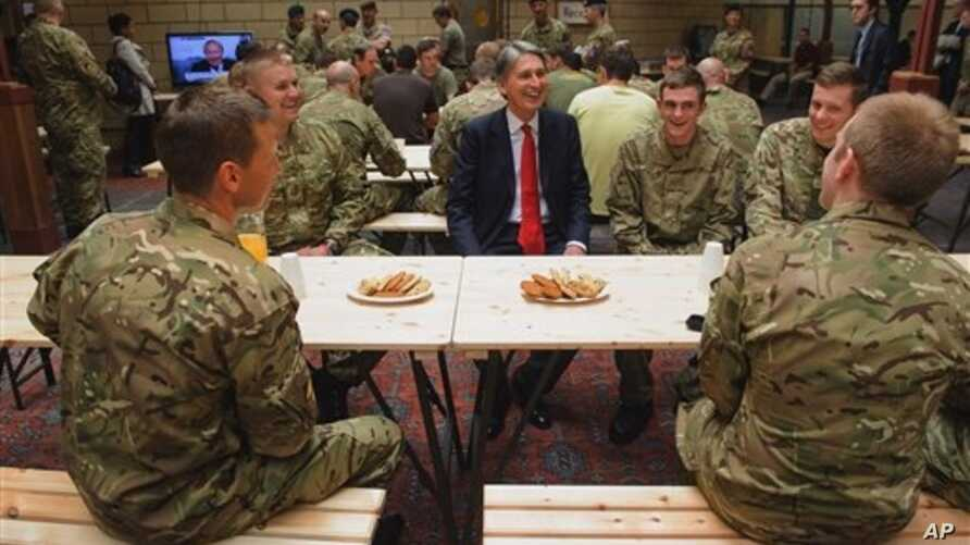 British Defense Secretary Philip Hammond during visit to temporary Army barracks, east London, July 20, 2012.