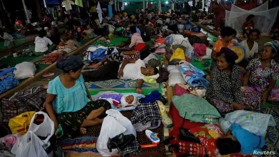 FILE - People displaced in the conflict between Kachin Independence Army (KIA) and Myanmar military for the control of an amber mine pass their time at a Christian church in Tanai township, Kachin state, Myanmar, June 16, 2017.