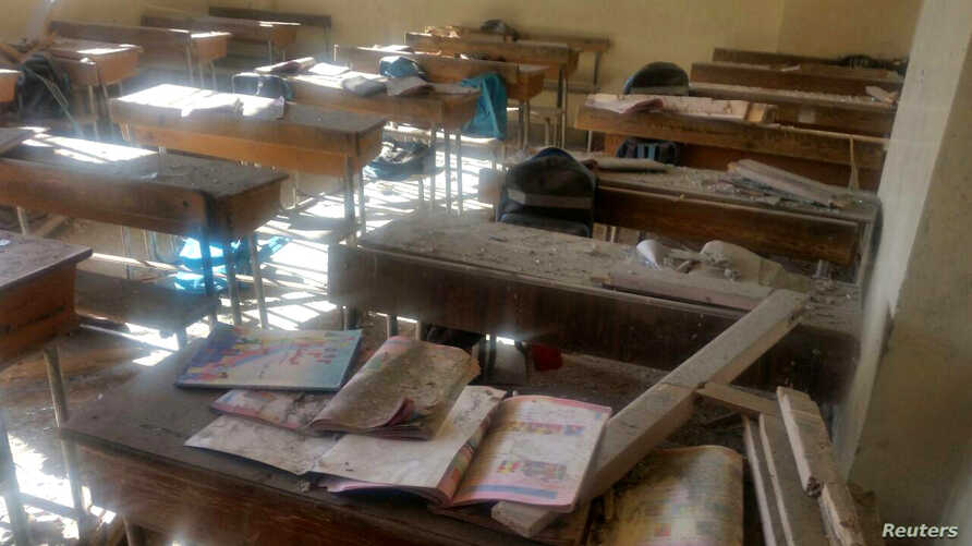A view shows the damage inside a classroom after shelling by Syrian rebels on government-held western Aleppo, Syria in this handout picture provided by SANA, Nov. 20, 2016.