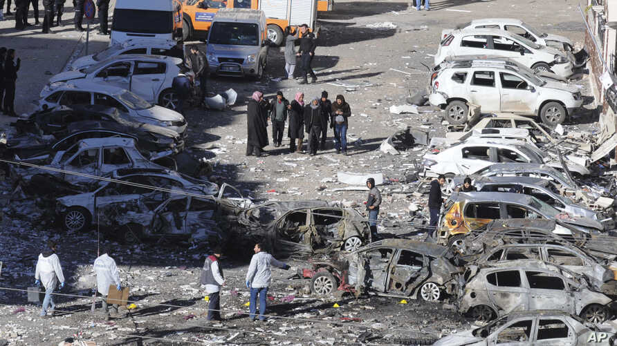 People inspect the damage from an overnight bomb attack in Viransehir, Turkey, Feb. 18, 2017. The bomb exploded near the homes of judges and prosecutors in the mainly-Kurdish town in Sanliurfa province, which borders Syria.