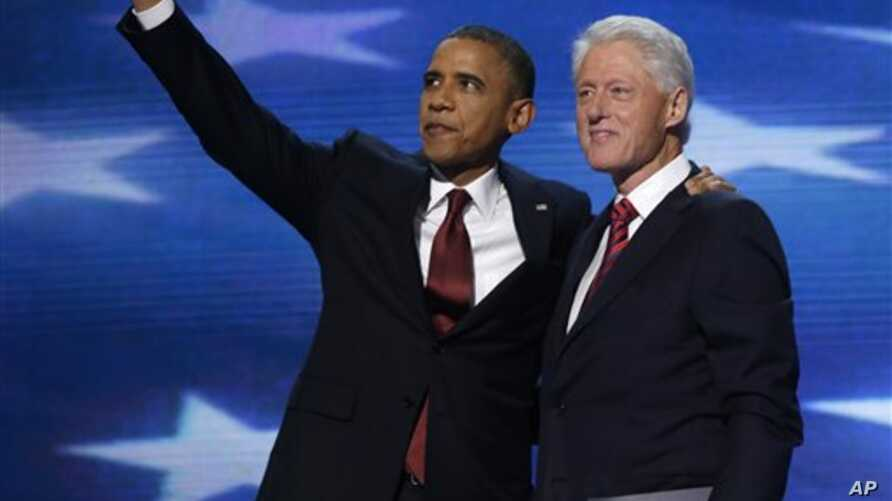 President Barack Obama waves as he joins Former President Bill Clinton during Democratic National Convention Sept. 5, 2012