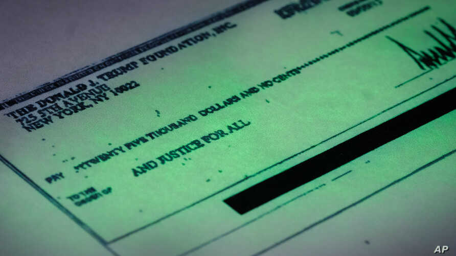 A Sept. 15, 2016 copy provided by the New York state attorney general shows a $25,000 check from the Donald J. Trump Foundation to And Justice For All signed by Donald J. Trump. The $25,000 check was sent from his personal foundation to a political c...