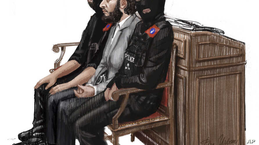 In this courtroom sketch, Salah Abdeslam, center, sits between two police officers during his trial at the Brussels Justice Palace in Brussels, Belgium, Feb. 5, 2018.