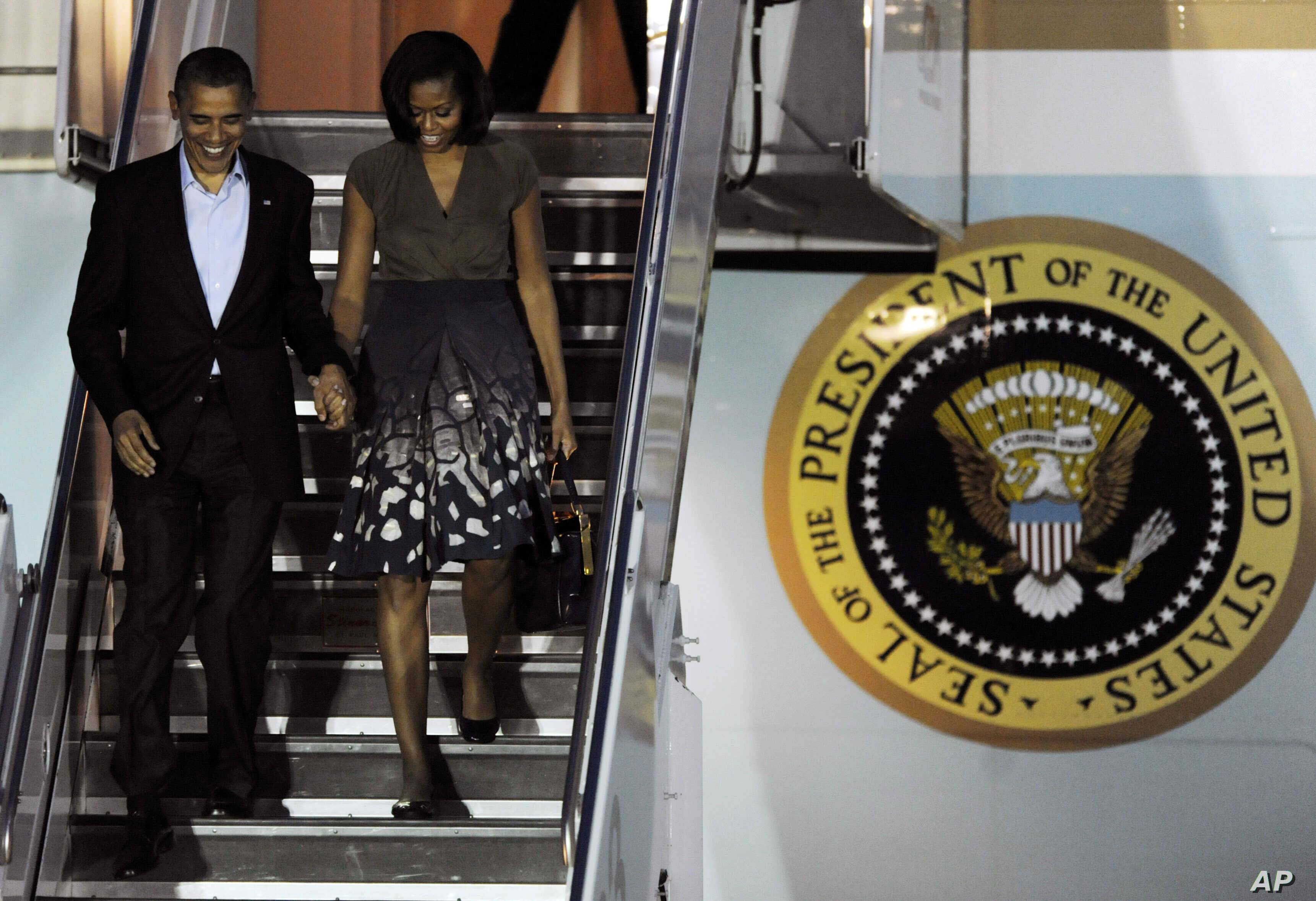 President Barack Obama and first lady Michelle Obama arrive at Chicago O'Hare International Airport to attend the NATO Summit, Saturday, May 19, 2012 in Chicago.