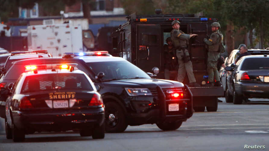 Police officers are seen at the scene of a shooting near a polling station in Azusa, California, Nov. 8, 2016.