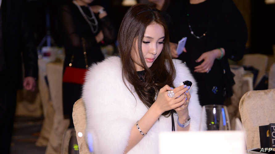 Guo Meimei attends a jewelry auction in Beijing, China, Dec. 1, 2013.
