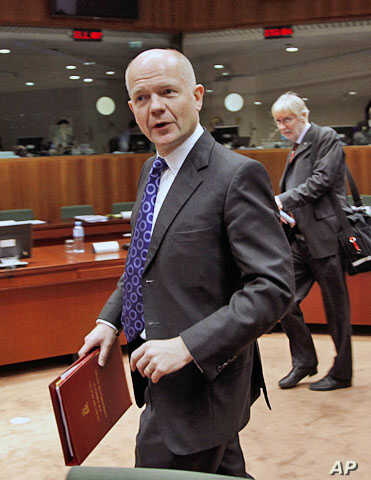 Britain's Foreign Secretary William Hague arrives at a European Union foreign ministers meeting at the EU Council headquarters in Brussels, December 1, 2011