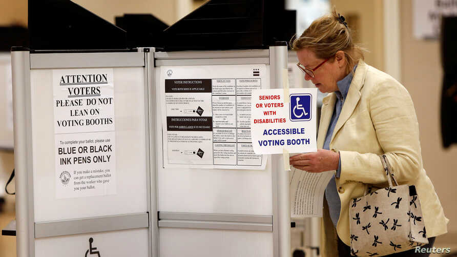A woman casts her ballot in the District of Columbia in the final 2016 U.S. Democratic primary of the year, June 14, 2016.