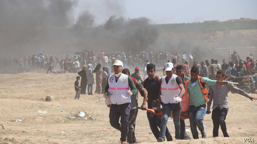 Protests in response to the U.S. Embassy opening in Jerusalem turned deadly as protesters rushed the borders despite Israeli fire and tear gas, in Gaza, May 14, 2018.