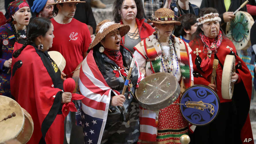 Native American tribal members sing and drum in the rotunda of the Capitol in Olympia, Wash. The gathering was part of Native American Indian Lobby Day and supported issues such as the Puyallup Tribe's protest against the construction of a liquified