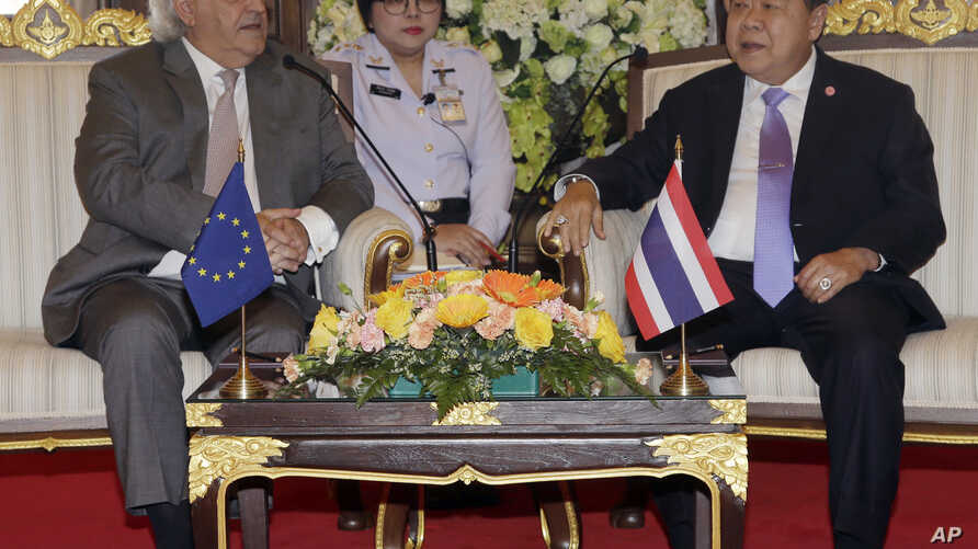 FILE - European Union delegation chief Cesar Deben, left, meets Thai Deputy Prime Minister and Defense Minister Prawit Wongsuwan in Bangkok, Thailand, Jan. 22, 2016. The EU is maintaining the threat of a seafood import ban on Thailand.