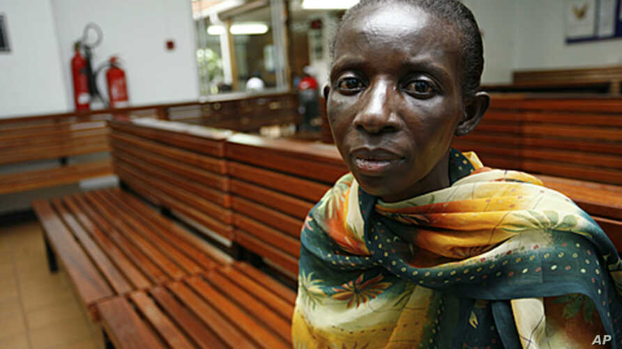 Jolly Nyamigisha, 40, a Ugandan woman living with HIV/AIDS waits to receive antiretroviral drugs from the Infectious Disease Institute (IDI) at the Uganda referral hospital, Mulago, near the capital Kampala, (File).
