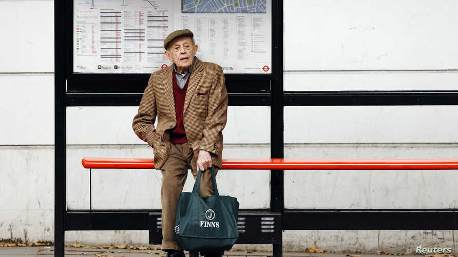 """FILE - A man sits by himself at a bus stop in London, Oct. 18, 2013. Health Secretary Jeremy Hunt said at the time that there were hundreds of thousands of people in England who were chronically lonely. A """"minister of loneliness has now been appointe"""