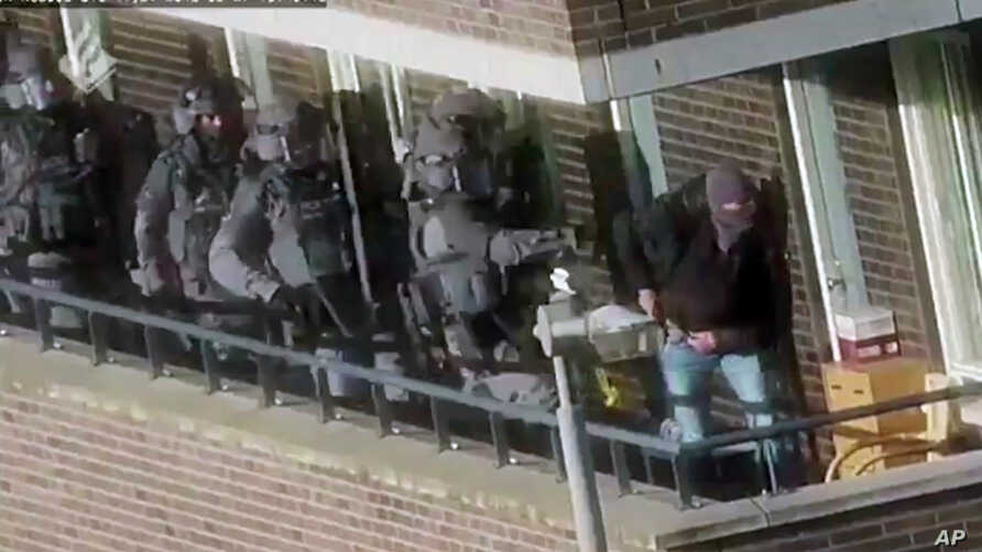 FILE - In this image made from video provided by Netherlands police, armed police prepare for an operation in Arnhem, Netherlands, Sept. 27, 2018, in which seven men ultimately were arrested on suspicion of plotting a large-scale extremist attack. On