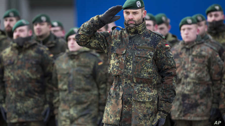 German Bundeswehr soldiers of the 12th Mechanized Infantry Brigade, 122nd Infantry Battalion, take part in a NATO enhanced forward presence battalion welcome ceremony at the Rukla military base 130 km (80 miles) west of Vilnius, Lithuania, Feb. 7, 20