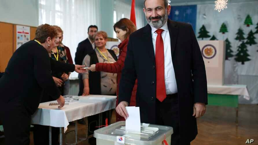 Acting Armenian Prime Minister Nikol Pashinian casts his ballot in a polling station during an early parliamentary election in Yerevan, Armenia, Sunday, Dec. 9, 2018.