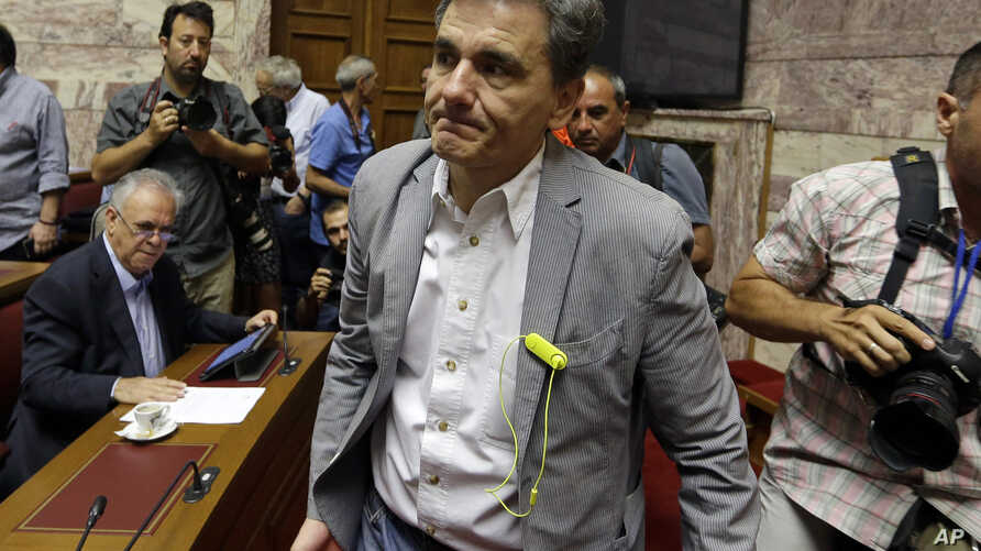 Greek Finance Minister Euclid Tsakalotos arrives for a meeting with lawmakers of Syriza party at the Greek Parliament in Athens, July 10, 2015.