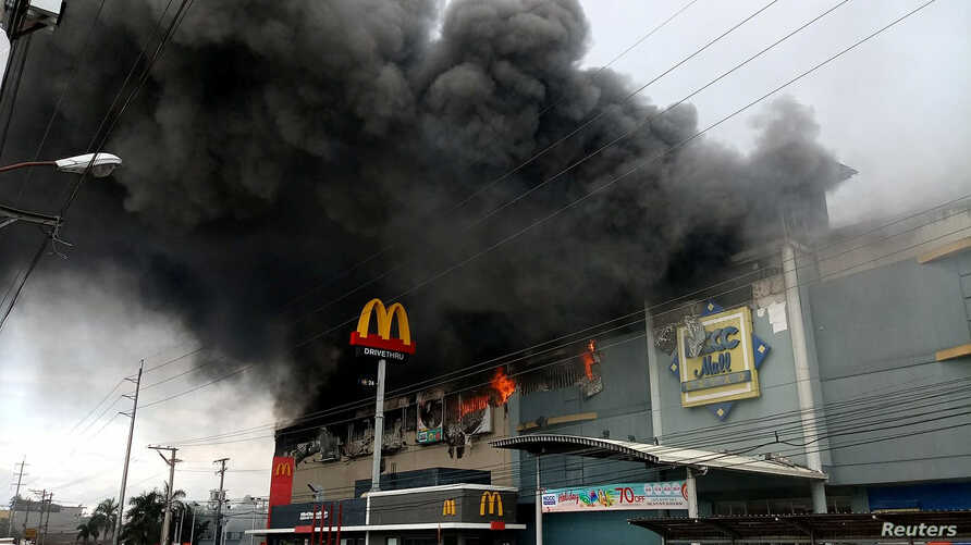 Smoke billows from a shopping mall fire in Davao City, the Philippines, Dec. 23, 2017, in a photo obtained from social media. Yas D. Ocampo/via Reuters