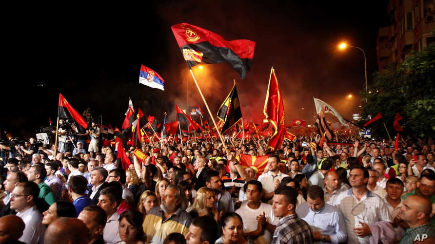 Supporters of the ruling conservative VMRO-DPMNE party rally in front of the Parliament building in Skopje, Macedonia, 18, 2015.