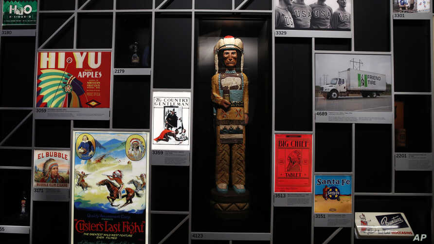 """Objects using imagery of Native Americans are on display at the """"Americans"""" exhibit at the Smithsonian's National Museum of the American Indian in Washington, Feb. 9, 2018."""