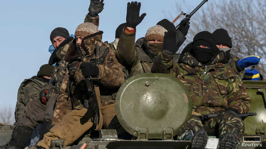 Members of the Ukrainian armed forces ride on a military vehicle near Debaltseve, eastern Ukraine, Feb. 17, 2015.