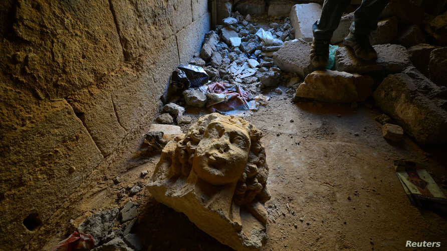 A destroyed artifact is seen at the ancient city of Hatra, south of Mosul, Iraq, April 27, 2017.