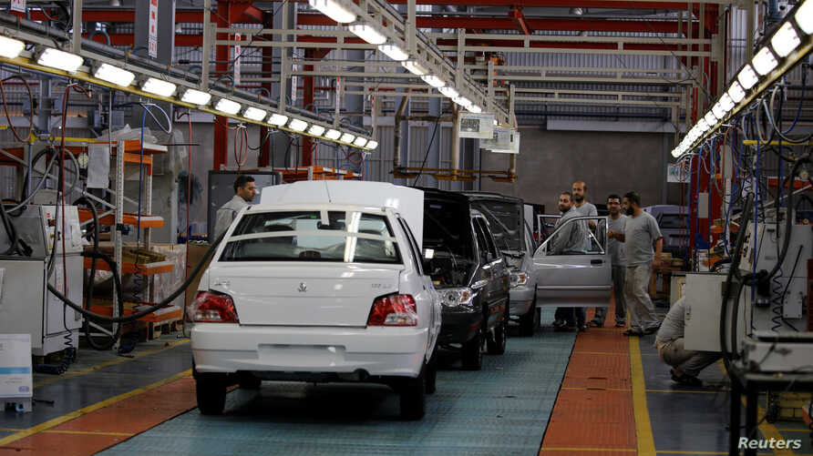 FILE - Cars are seen inside the Saipa Syria Factory in the industrial city of Hassia in Homs, Syria, Sept. 9, 2018.