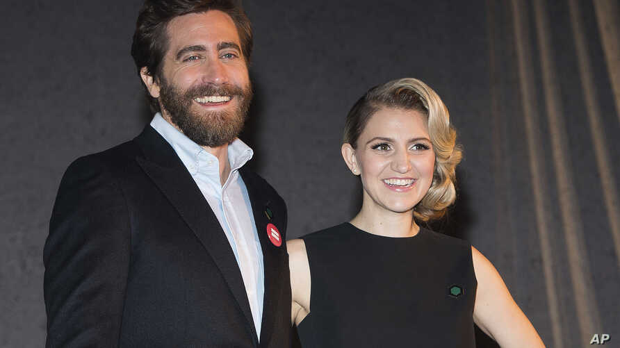 """Jake Gyllenhaal, left, and Annaleigh Ashford participate in Broadway's """"Sunday in the Park with George"""" media day and Hudson Theatre grand re-opening ceremony in New York, Feb. 8, 2017."""