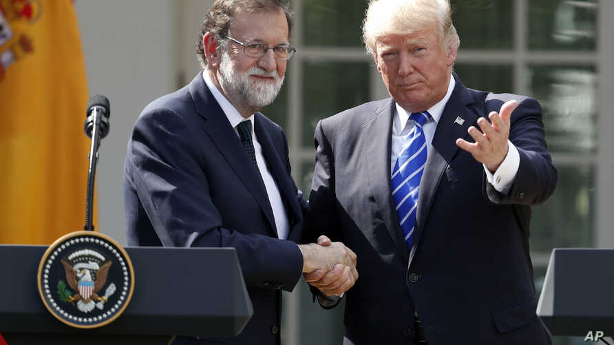 President Donald Trump shakes hands with Spanish Prime Minister Mariano Rajoy at the conclusion of a news conference in the Rose Garden of the White House, Sept. 26, 2017, in Washington.