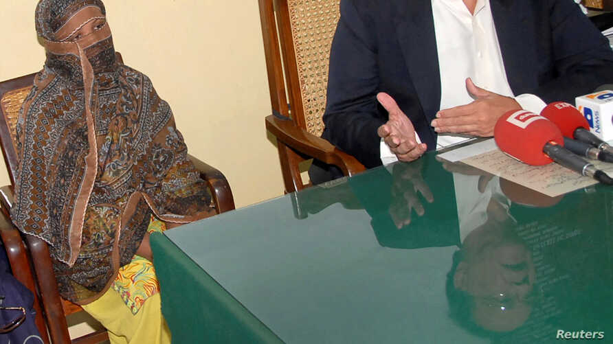 FILE - Pakistani Christian woman Asia Bibi is seen after a meeting with the governor of the Punjab Province at a jail in Sheikhupura, Pakistan.