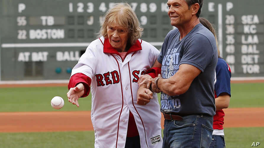FILE - About to turn 100-years-old, Babe Ruth's daughter Julia Ruth Stevens throws out the ceremonial first pitch with help from her son Tom before a baseball game between the Boston Red Sox and the Tampa Bay Rays at Fenway Park in Boston, Saturday,