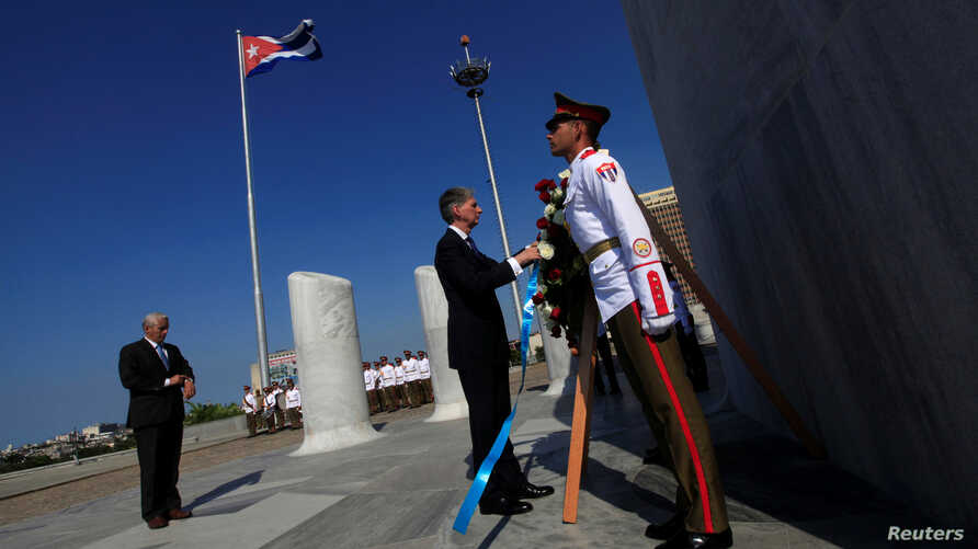 Britain's Foreign Secretary Philip Hammond (C) attends a wreath laying ceremony for Cuba's independence hero Jose Marti at Revolution Square in Havana, April 28, 2016.