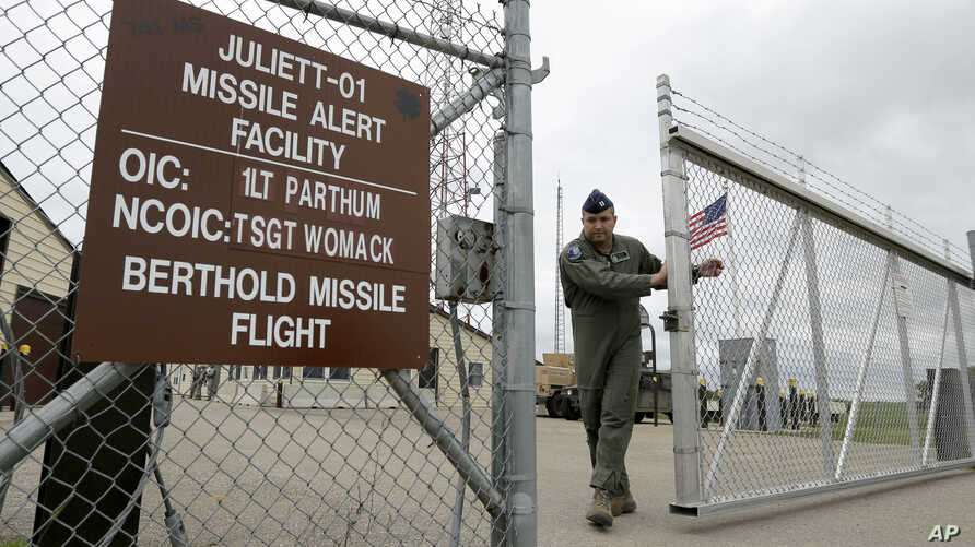 FILE - In this June 24, 2014 file photo, a gate is closed at an ICBM launch control facility in the countryside outside Minot, N.D., on the Minot Air Force Base.
