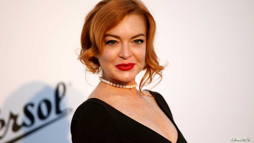 Lindsay Lohan poses at amfAR's Cinema Against AIDS event at the 70th Cannes Film Festival, Antibes, France, May 25, 2017.