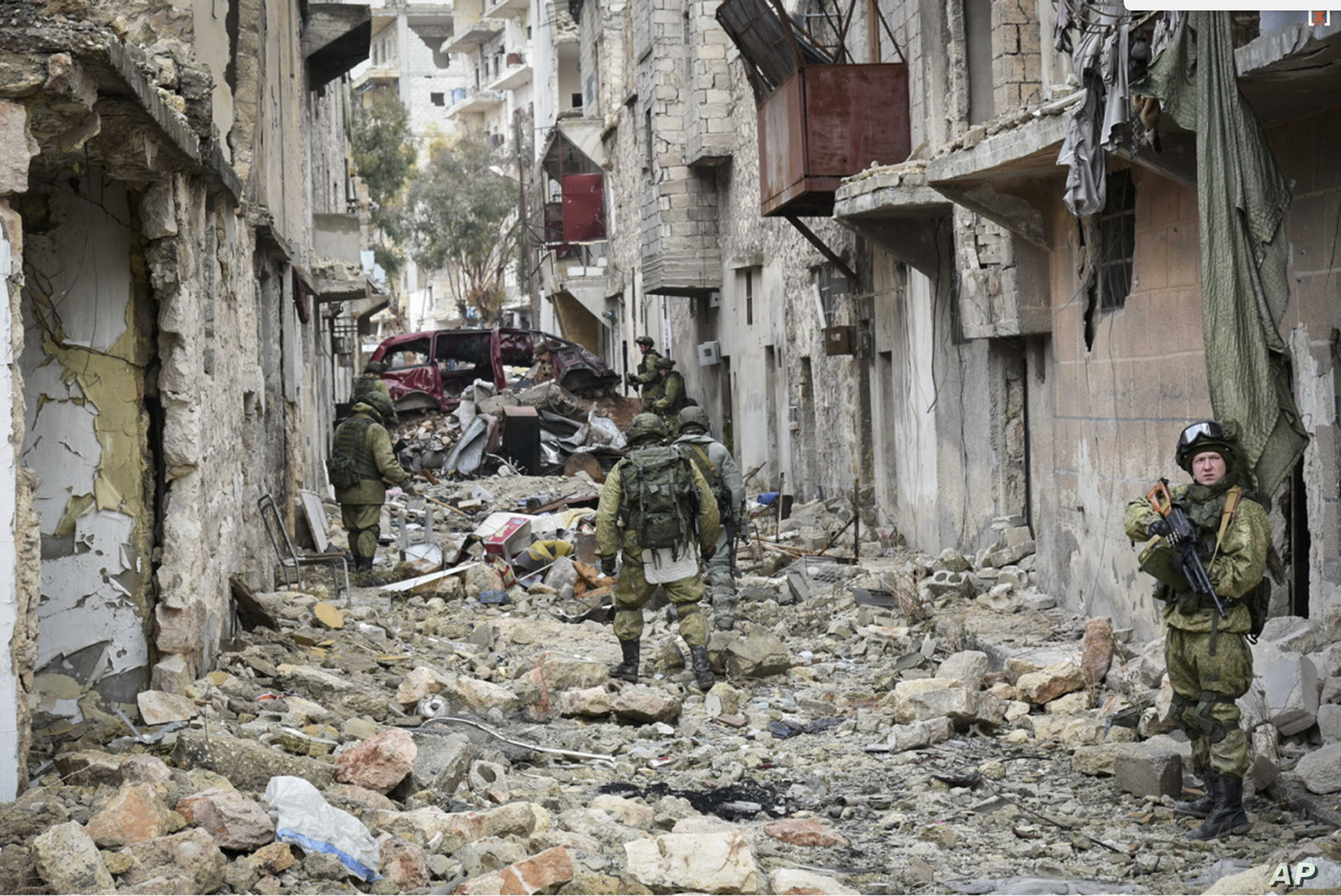 This undated handout photo released, Jan. 2, 2017, by the Russian Defense Ministry claims to show Russian Military engineers operating in Aleppo, Syria.