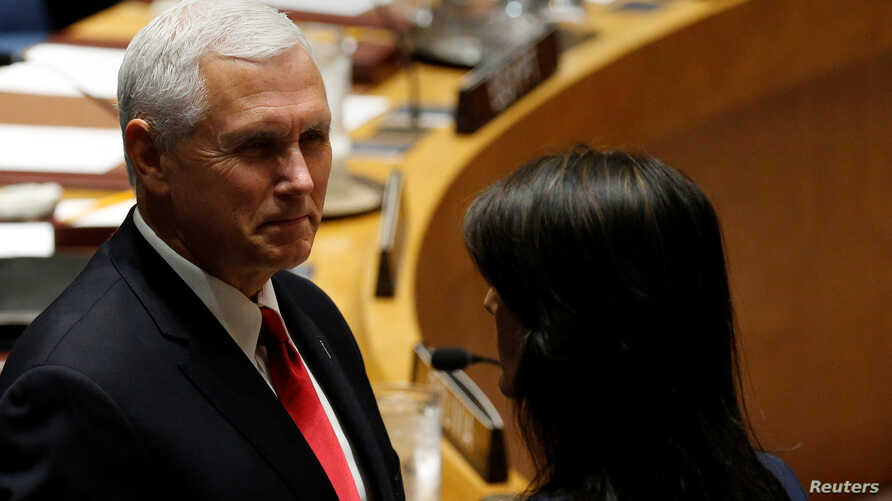 U.S. Vice President Mike Pence and U.S. Ambassador to the United Nations Nikki Haley stand before the start of a U.N. Security Council meeting on peacekeeping at the 72nd U.N. General Assembly at U.N. headquarters in New York, Sept. 20, 2017.