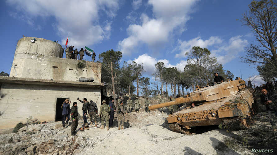FILE - Turkish forces and Free Syrian Army members are seen on Mount Barsaya, northeast of Afrin, Syria Jan. 28, 2018.
