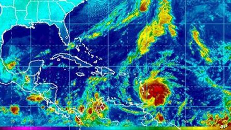 This image provided by NOAA shows Tropical Storm Tomas, lower center, taken early Saturday morning 30 Oct 2010