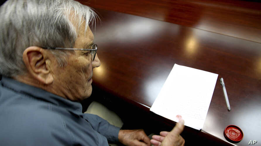 Noth Korea Detained AmericanIn this photo released by the Korean Central News Agency Nov. 30, 2013, U.S. citizen Merrill Newman, 85, applies his thumb print to a document North Korean authorities say was an apology Newman wrote and read in North Kore
