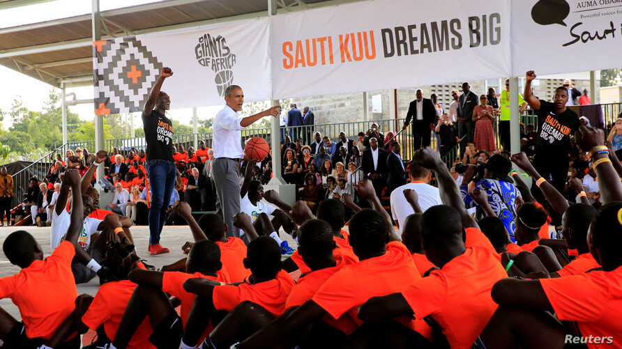 Former U.S. President Barack Obama addresses players at the basketball court during the launch of Sauti Kuu resource centre near his ancestral home in Nyangoma Kogelo village in Siaya county, western Kenya, July 16, 2018.
