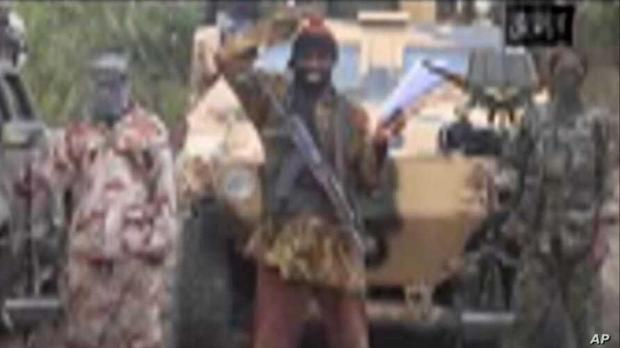 FILE - The leader of Nigeria's Islamic extremist group Boko Haram, Abubakar Shekau, speaks in this file image made from video received by The Associated Press on May 5, in which his group claimed responsibility for the April 15 mass abduction of near